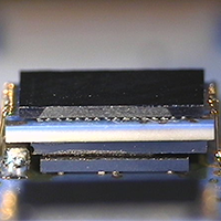 3D stacked chip for a digital hearing amplifier hybrid